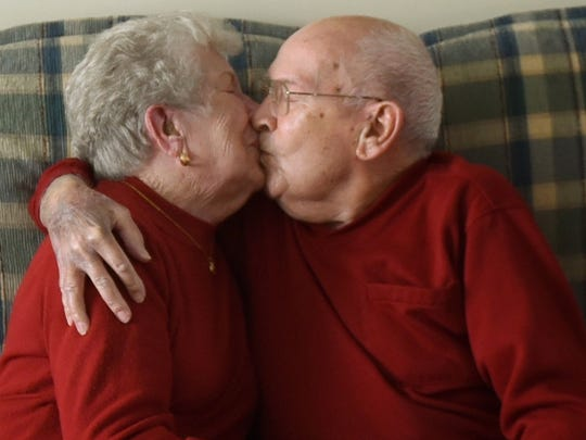Jim and Peggy Fegan share a kiss in their Chambersburg home Tuesday, Feb. 2, 2016. The couple recently celebrated 70 years of marriage.