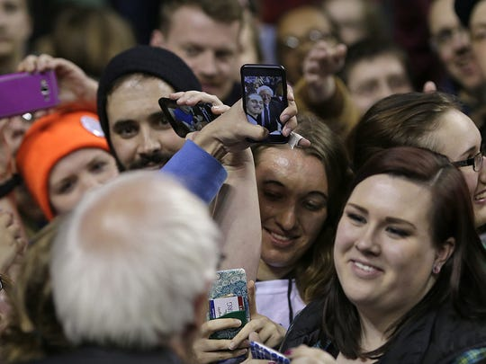 Democratic presidential candidate Bernie Sanders takes a selfie with a fan during his campaign stop Friday at the Kress Events Center at UW-Green Bay.