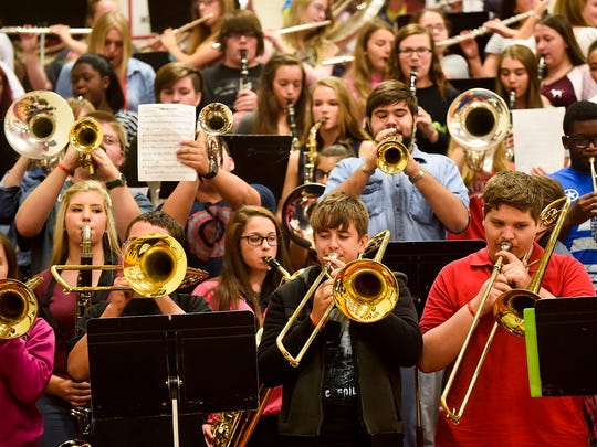 The Marion Harding High School band plays 'Hang on Sloopy' following a speech by the Ohio State University President Dr. Drake on Wednesday morning.