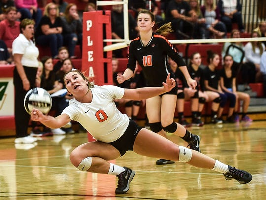 North Union's Paxon Stofcheck dives to return the ball during the Pleasant vs North Union Volleyball game on tuesday night.