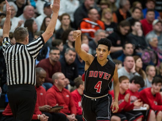 Dover's Keith Davis reacts after making a three-pointer as Palmyra defeated Dover 61-53 in the first round of the District 3 5A basketball tournament on Monday, Feb. 20, 2017.