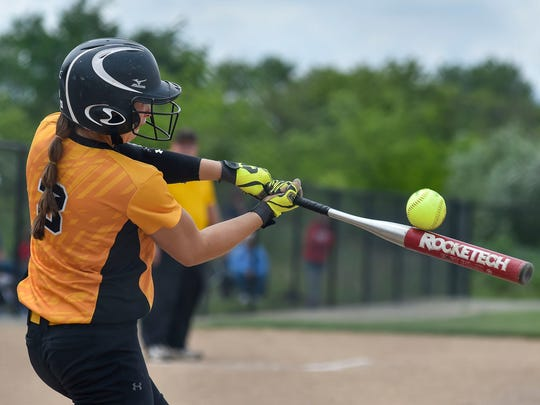 Colonel Crawford's Alexus Burkhart foul tips a pitch during Colonel Crawford's regional semi-final loss to Eastwood Wednesday at Findlay.