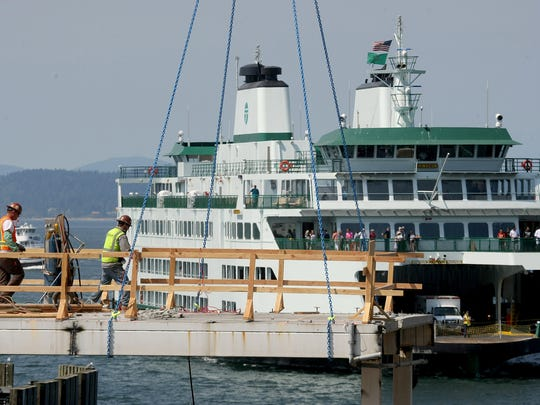 A new passenger only ferry terminal is being built as part of a $350 million renovation of Colman Dock in Seattle. While work on the new foot ferry dock is done, passenger ferries will use a temporary facility north of Colman Dock.