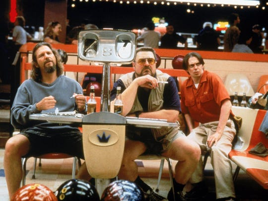 Jeff Bridges as the Dude, left with John Goodman and