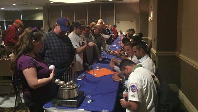 Binghamton Mets players sign autographs during the Welcome Back Dinner at the Holiday Inn in on Hawley Street in Binghamton prior to the opening of the 2015 Eastern League season.