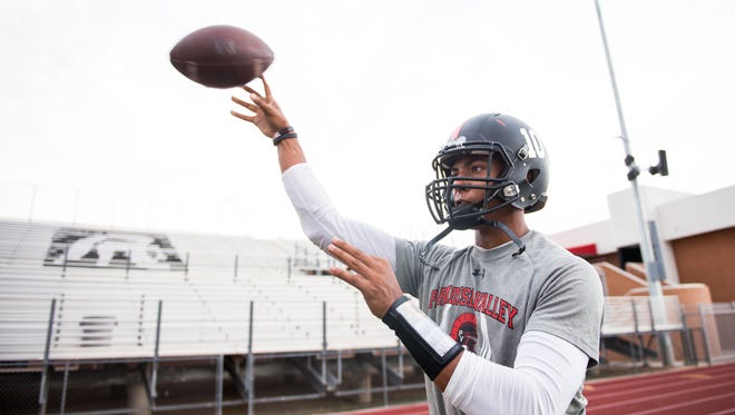 Quarterback Daniel Bridge-Gadd throws on the sidelines at football practice at Paradise High School in Phoenix, AZ, on Wednesday, July 29, 2015.