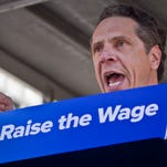 Gov. Andrew Cuomo speaks during a labor rally Thursday in New York, announcing a plan to get a minimum $15 an hour wage hike for fast-food workers.