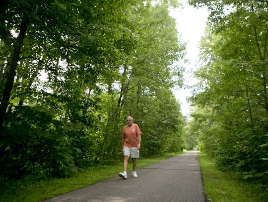 Jon Cook of Wisconsin Rapids walks along the Ahdawagam