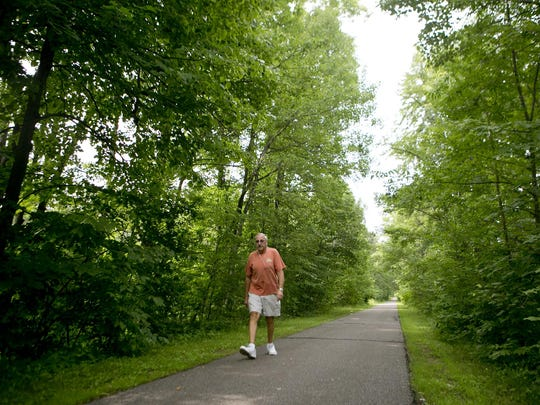 Jon Cook of Wisconsin Rapids walks along the Ahdawagam Blue Trail in Wisconsin Rapids. A proposed ordinance change would allow dogs on city-owned trails.