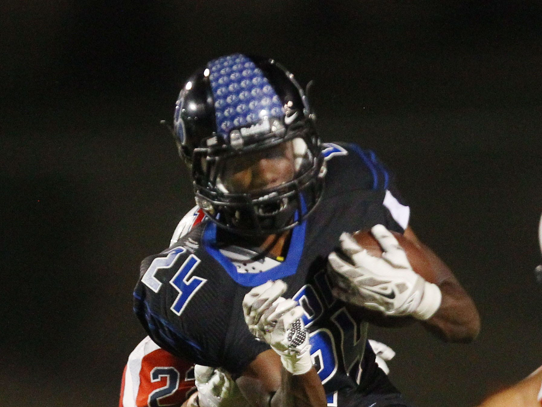 At right, Cathedral City High School's James Green III is stopped for a loss of yardage by Heritage High School's Javier Luna during Cathedral City's lost at home.