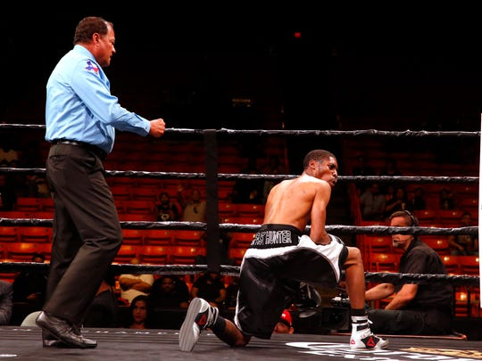 Rondarius Hunter looks over at his corner after going down in the one of the early rounds in fight against Robert Rodriguez at the Don Haskins Center. Rodriguez would go on to win the fight by unanimous decision and push his record to 2-0.