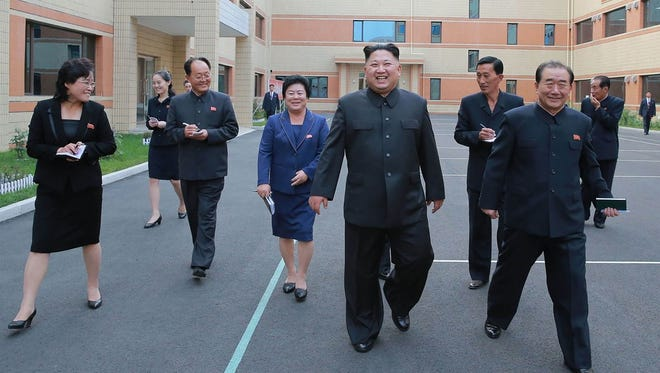 This undated picture released from North Korea's official Korean Central News Agency (KCNA) on October 19, 2017 shows North Korean leader Kim Jong Un, center, visiting the Ryuwon Footwear Factory in Pyongyang.