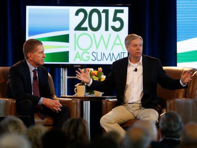 Sen. Lindsey Graham (right) talks with Bruce Rastetter