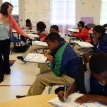 Sixth-grade students work during math class at Earl Travillion Attendance Center.