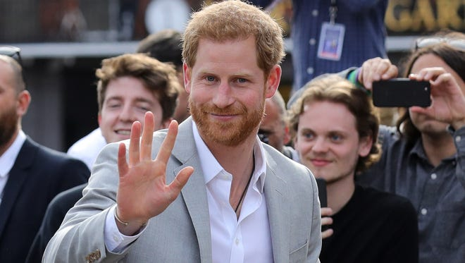 Prince Harry greets well-wishers on a walkabout in Windsor ahead of his wedding with American Meghan Markle, on May 18, 2018.