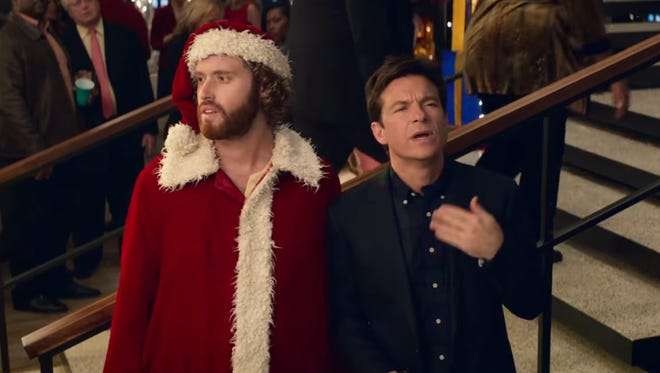 """T.J. Miller and Jason Bateman star in """"Office Christmas Party,"""" which also stars Olivia Munn, Jennifer Aniston and Kate McKinnon."""