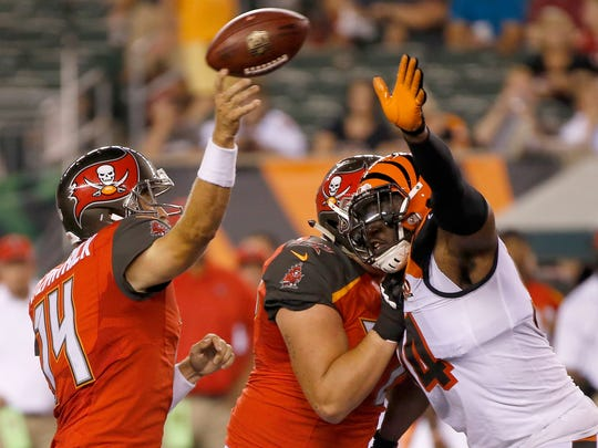 Tampa Bay Buccaneers quarterback Ryan Fitzpatrick (14) is rushed by Cincinnati Bengals defensive end Chris Smith (94) who breaks up the pass in the fourth quarter of the NFL Preseason Week 1 game between the Cincinnati Bengals and the Tampa Bay Buccaneers at Paul Brown Stadium in downtown Cincinnati on Friday, Aug. 11, 2017. The Bengals won the preseason opener, 23-12.