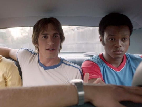 "Blake Jenner, center, is a freshman learning about college socializing in 1980 in ""Everybody Wants Some!!"""