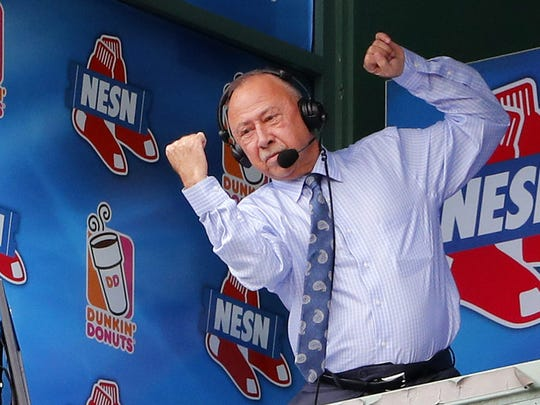 Jun 25, 2017; Boston, MA, USA; NESN broadcaster Jerry Remy feigns a punch from the broadcast booth as he is acknowledged by fans while battling cancer during the Los Angeles Angels 4-2 win over the Boston Red Sox at Fenway Park. Mandatory Credit: Winslow Townson-USA TODAY Sports ORG XMIT: USATSI-351144 ORIG FILE ID:  20170625_ggw_bt1_066.JPG