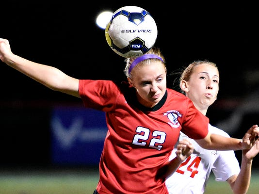 Dover's Hannah Maute, left, heads the ball while Susquehannock's Carly Attig, right, looks to defend during girls soccer action in Glen Rock, Pa. on Tuesday, Oct. 13, 2015. Dawn J. Sagert - dsagert@yorkdispatch.com