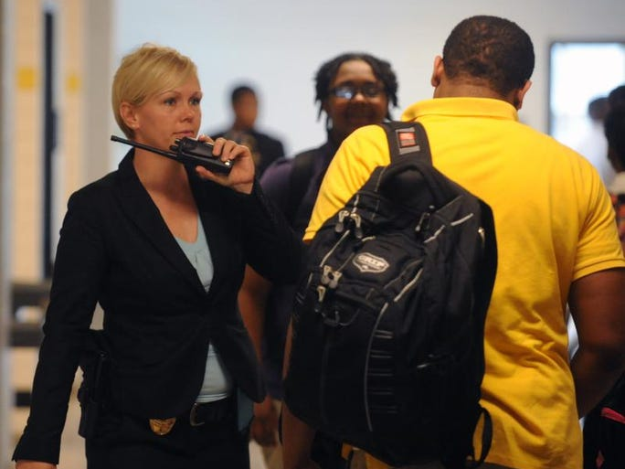 Jennifer Bass makes her way down the hall at Hattiesburg High. Bass is the newest resource officer in the Hattiesburg Public School District.