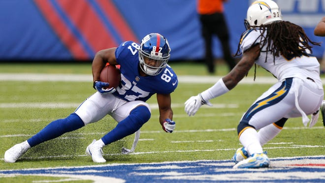 New York Giants wide receiver Sterling Shepard (87) makes a catch in front of Los Angeles Chargers free safety Tre Boston (33) during first quarter at MetLife Stadium.