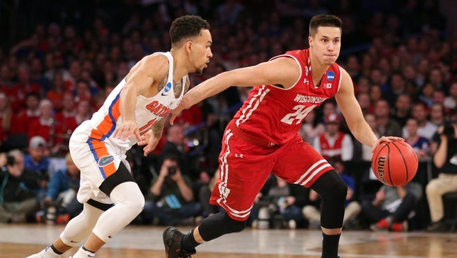 Former UW star Bronson Koenig (right) was performing well during a pre-draft workout for the Milwaukee Bucks until he rolled his right ankle about three-quarters of the way through the practice.