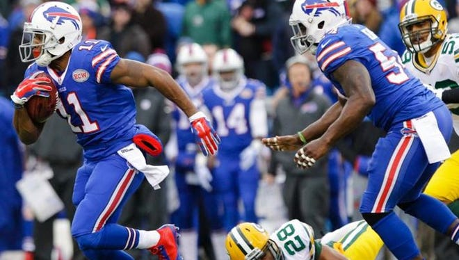 Buffalo Bills running back Marcus Thigpen (11) runs past Green Bay Packers' Sean Richardson (28) on a punt return for a touchdown during the first half of the game.