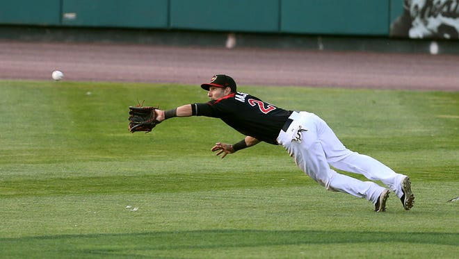 Red Wings center fielder Darin Mastroianni makes a diving catch on a line drive by Lehigh Valley's Brock Stassi.