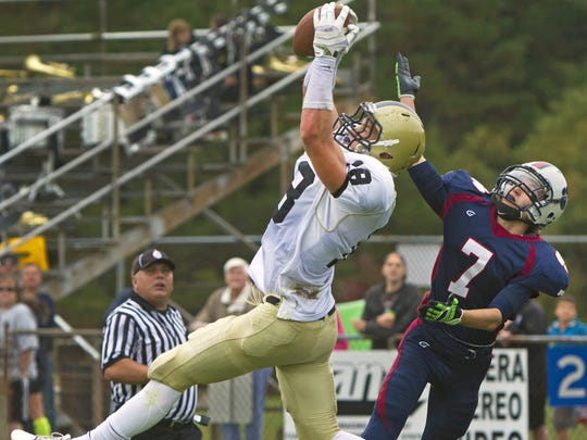 Mike Gesicki, now a tight end at Penn States, goes high for a ball while playing at Southern in 2013 in a game against Lacey.