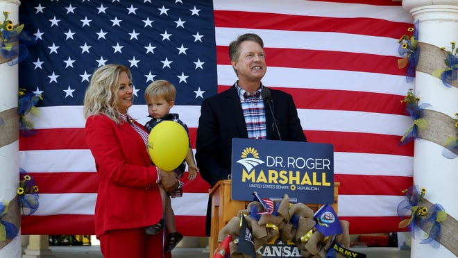 Congressman Roger Marshall announces that he is running for the United States Senate at the Kansas State Fair with his wife, Laina Marshall, and grandson, Weston Weems, 2.