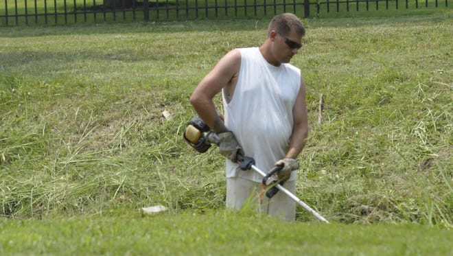 Convicted double murderer Benjamin Peirce trims weeds Tuesday at Cooper Park in Mountain Home. Peirce's unsupervised work at the park is at an end, according to Mayor Joe Dillard.