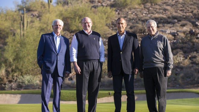 Drew Brown, founder and principal of DMB Associates, left, Brent Herrington, president of DMB Development, Bennett Dorrance, founder and principal of DMB Associates, and Mark Sklar, founder and principal of DMB Associates, pose for a photo on the 18th hole at DC Ranch's Silverleaf Club in Scottsdale on January 12, 2018.
