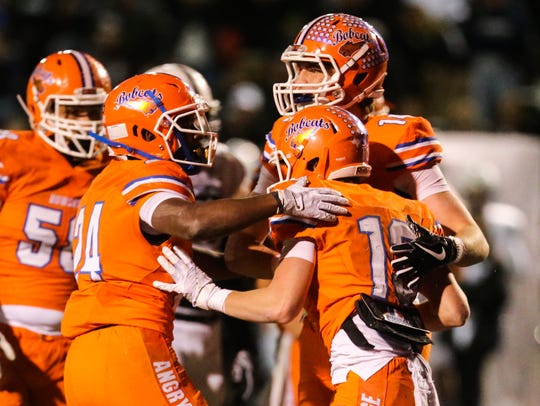 Central team celebrates a touchdown against Permian