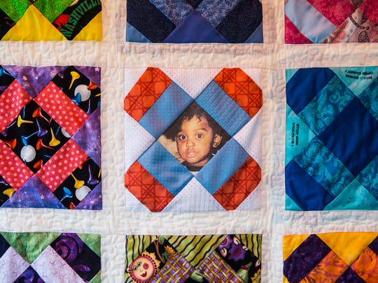 "June 2, 2018 - The portrait of a young child is displayed on the Tennessee Mother's Dream Quilt during the Wear Orange Block Party at Howze Park on Saturday. According to momsdemandaction.org the blocks in every quilt ""uses the uniform quilting pattern known as 'Mother's Dream.' Each quilt also contains at least one block composed of meaningful fabric from a victim or survivor of gun violence. Blocks representing victims and survivors are surrounded by quilt blocks submitted by mothers who share in our collective sadness over too many lives shattered by gunfire."" The event, hosted by the Memphis chapter of Moms Demand Action for Gun Sense in America, had activities for kids and families as well as a remembrance for victims and survivors of gun violence."