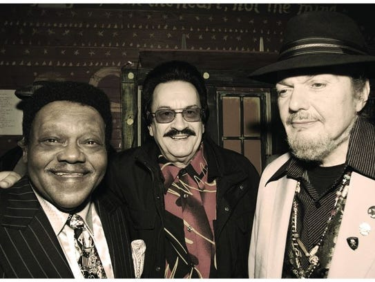 Warren Storm, center, stands with Fats Domino, left,