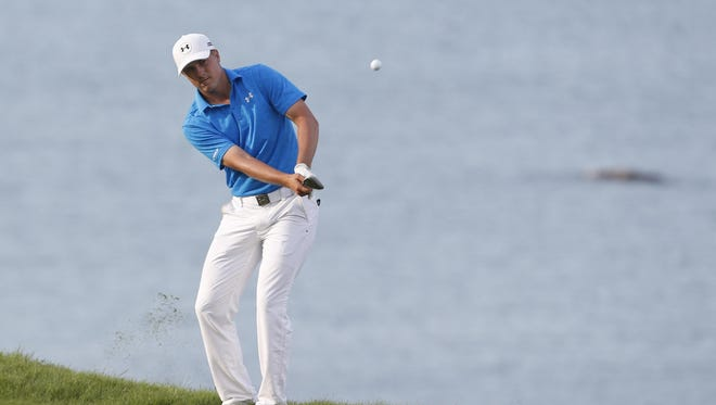 Jordan Spieth chips onto the 17th green during the first round of the 2015 PGA Championship golf tournament at Whistling Straits.