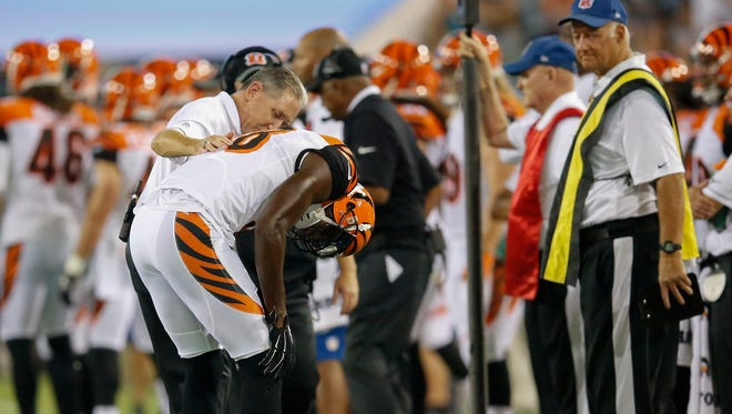 Bengals wide receiver A.J. Green exits Sunday's loss to Jacksonville after suffering an injury in the first quarter.
