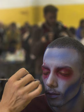 2014: Tony Mandile, special effects supervisor, works on the face of Lavon Patterson of Philadelphia at Six Flags Great Adventure in Jackson. Photo taken on October 20, 2014 in Jackson NJ.