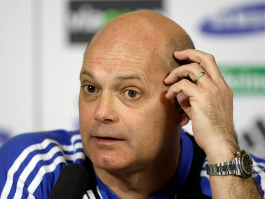 FILE - In this Friday, Feb. 13, 2009 file photo, Chelsea coach Ray Wilkins speaks during a news conference at the team's training facilities in Stoke d'Abernon, England. Ray Wilkins, who captained England's national soccer team and played for illustrious teams such as Manchester United, Chelsea and AC Milan in a 24-year career, died Wednesday April 4, 2018. He was 61. (AP Photo/Matt Dunham, File)