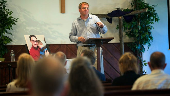 Tate Love speaks during the anniversary service remembering Julian Parrott at the Staunton Mennonite Church Saturday.