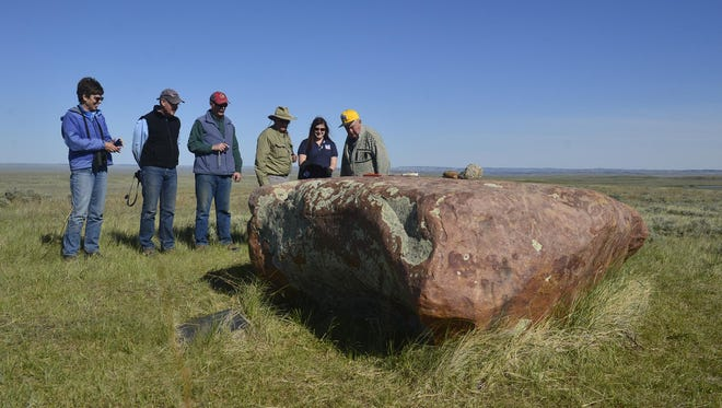 Vistors to the American Prairie Reserve view the Indian Lake Medicine Rock on a block of land neighboring reserve in May 19.