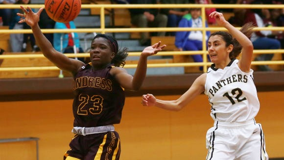 Andress' Alexis Singleton, left, and Austin's Ashley Lincon reach for a loose ball during the second quarter Tuesday.