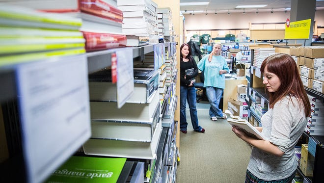 Joy Linn works in Ivy Tech's bookstore at the school's Cowan Road facility Wednesday.