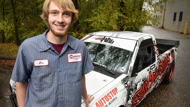 Alec Robbins smiles Wednesday, Oct., 26, next to his 1986 Nissan D21 drift truck at Auto Stop in Big Lake. Robbins recently won the Midwest Championship in the Enjuka Racing Midwest Drift Union title.