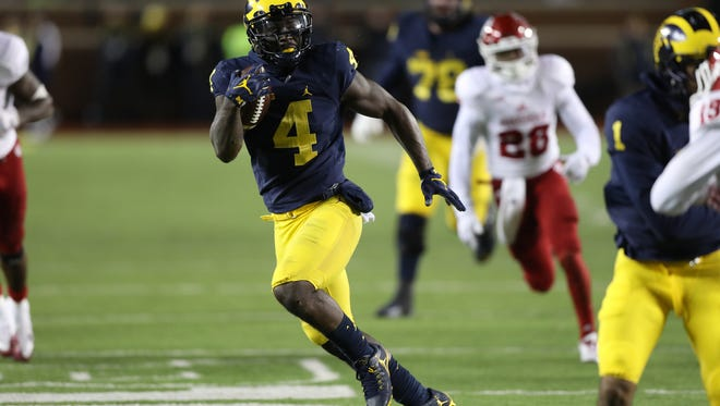 Michigan RB De'Veon Smith runs in for his second touchdown Indiana during the second half of U-M's 20-10 win Saturday in Ann Arbor.