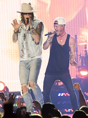 Brian Kelley and Tyler Hubbard of Florida Georgia Line perform during their Dig Your Roots Tour at Newark, New Jersey at Prudential Center on March 18, 2017 in Newark, New Jersey.