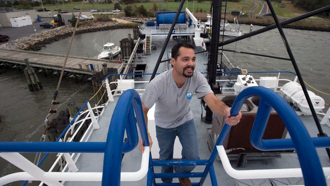 Deck engineer Richard J. Gaudiosi climbs aboard the Delriver while docked in Lewes.