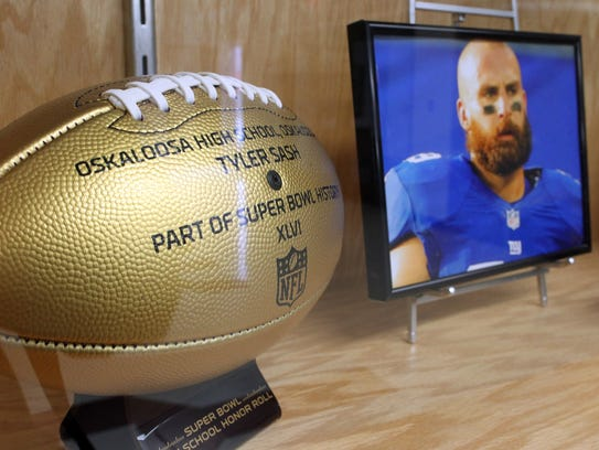 A commemorative football from Super Bowl XLVI, given