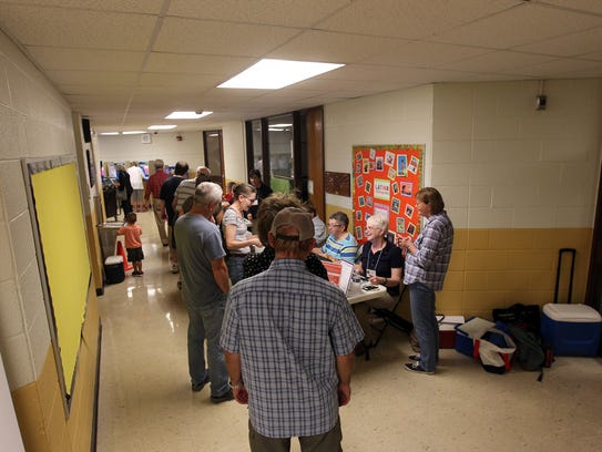 Voters wait in line at Lemme Elementary on Tuesday,